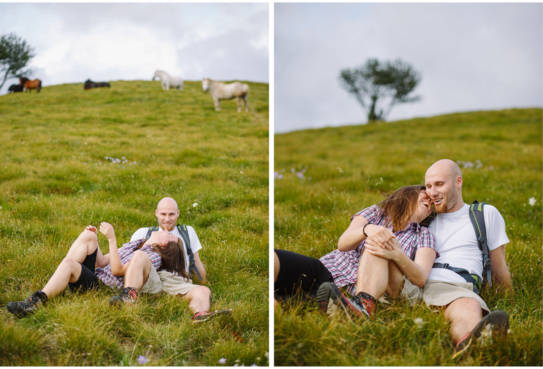 couple in long grass on engagement session