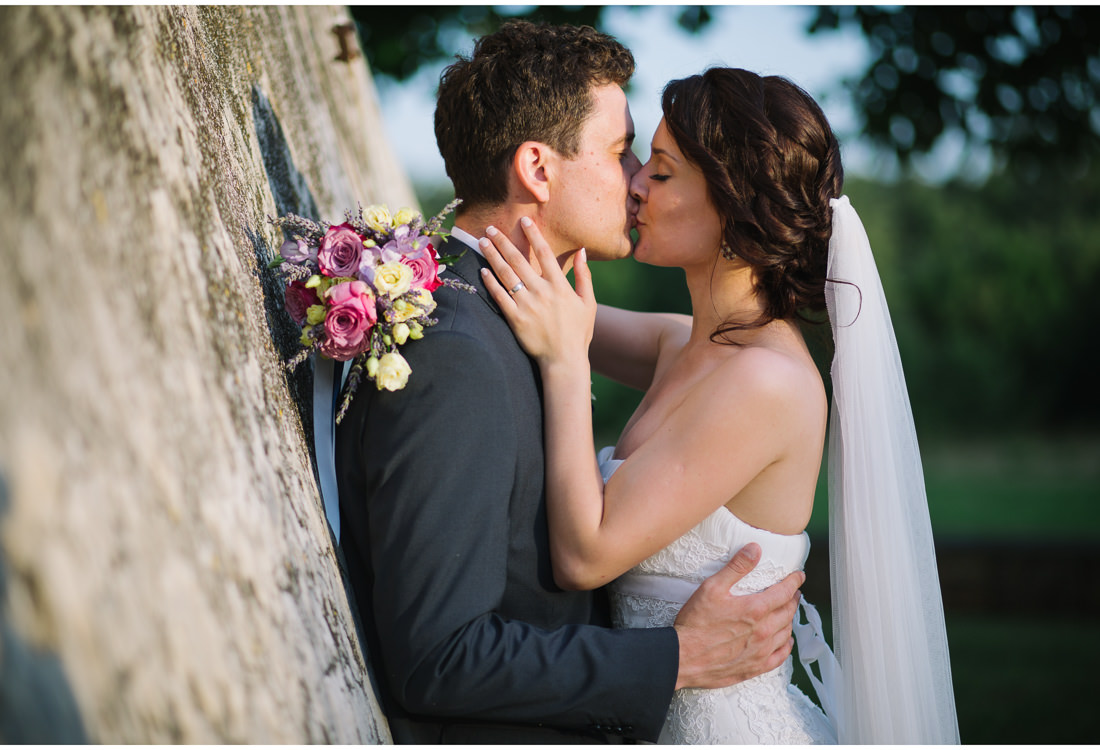 bride kissing groom