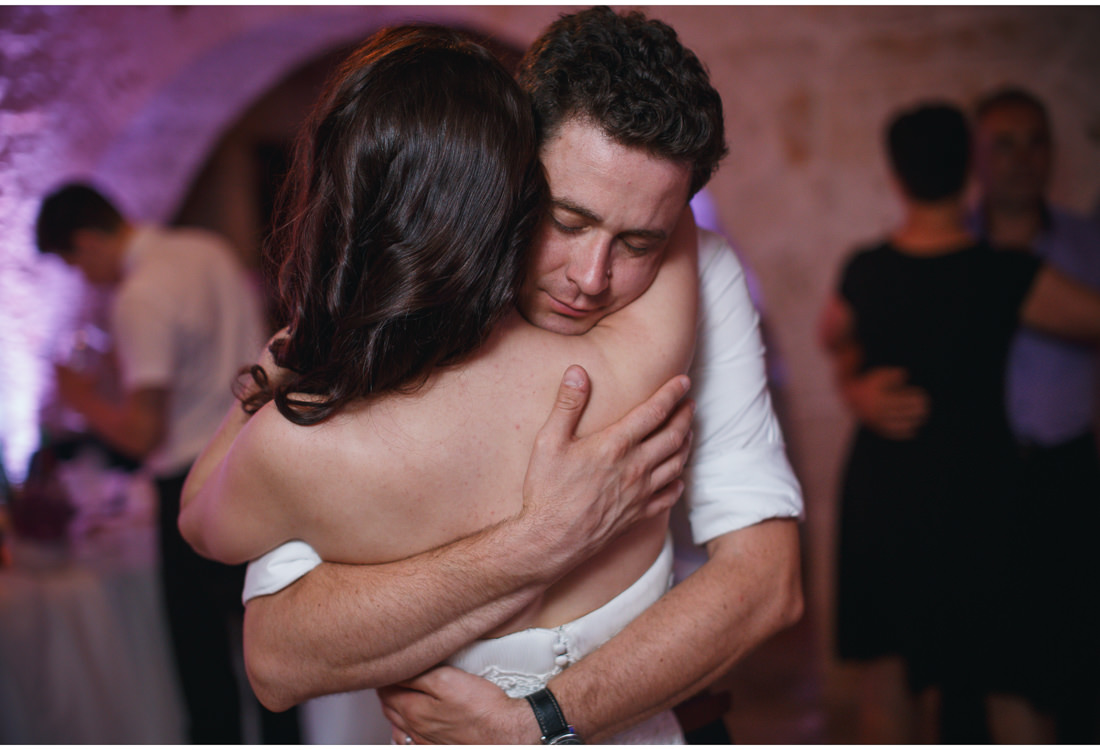 loving hug at a wedding