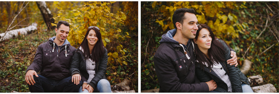 couple posing in front of yellow leaves