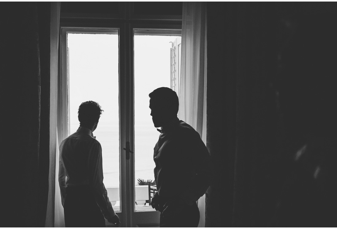 silhouettes of man in front of the window
