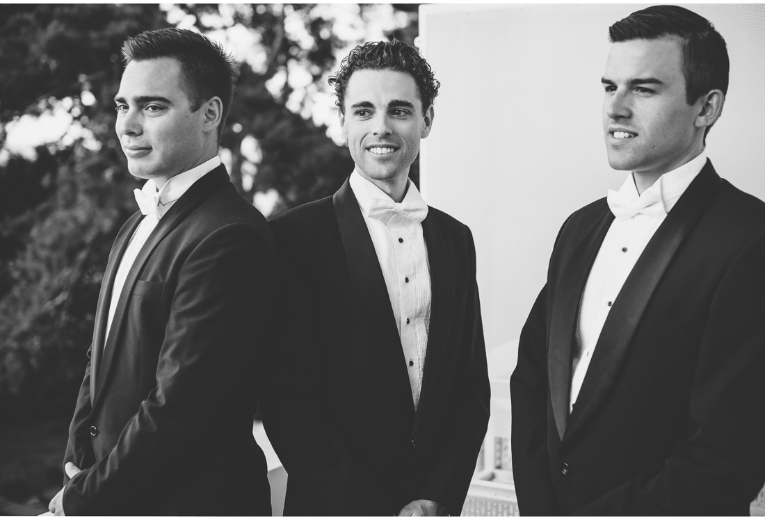 men in suits posing for a photo