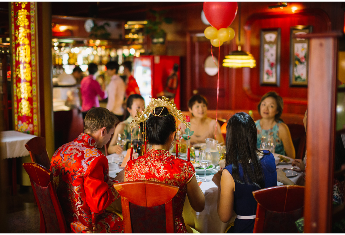 people in traditional chinese cloths sitting in chinese restaurant