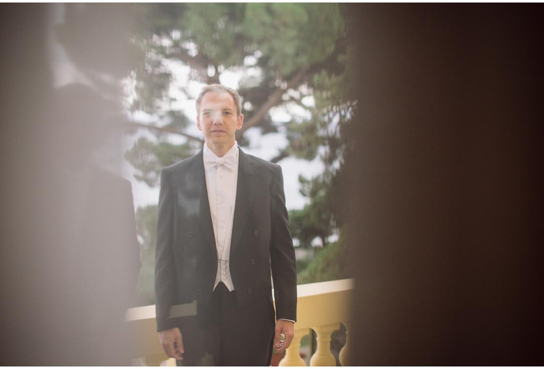 man in suit through glass window