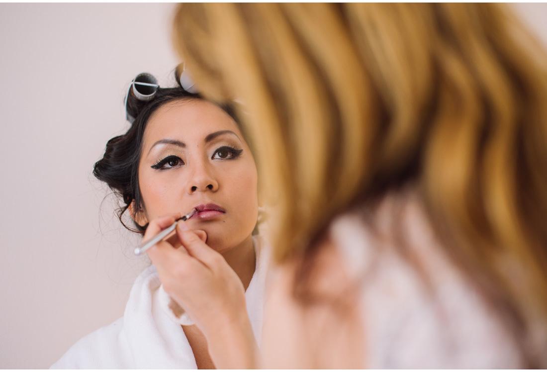 chinese woman putting make-up on