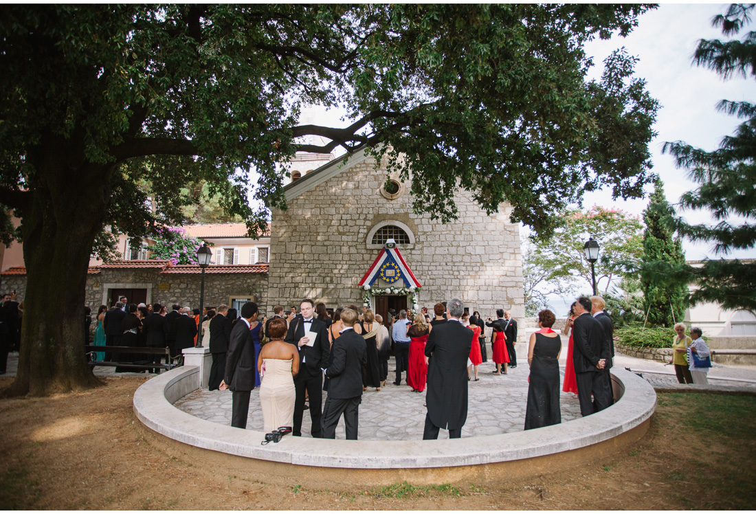 church in opatija with a wedding party in front