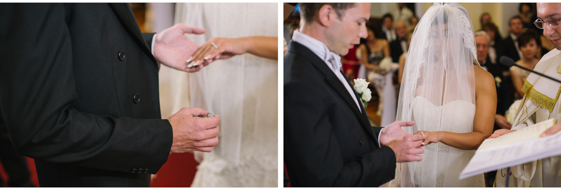groom putting a ring on brides finger
