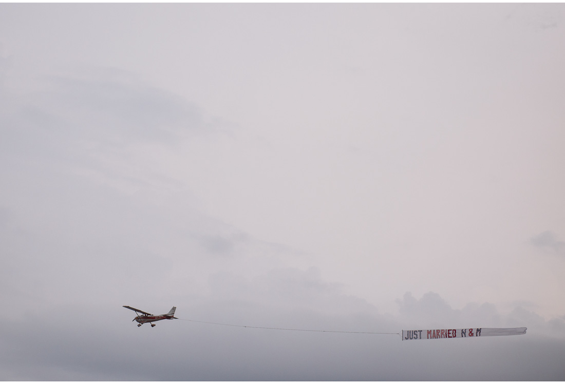 small plane carrying just married sign