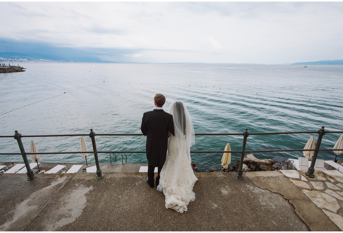 bride and groom looking at the sea