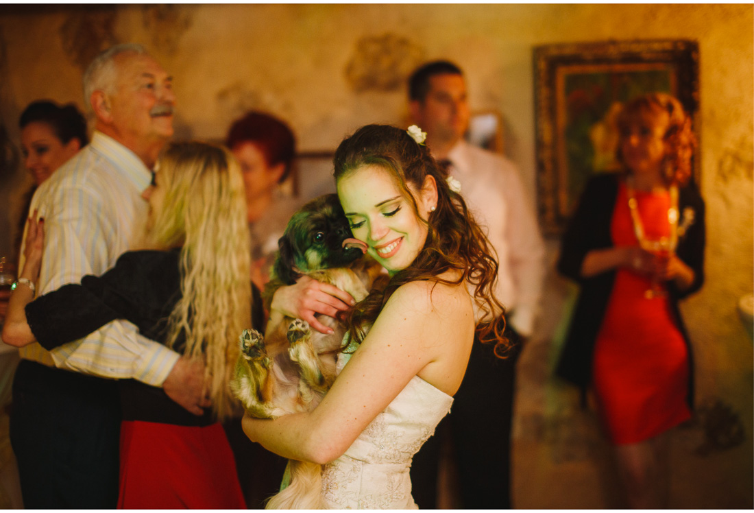 bride and dog kiss