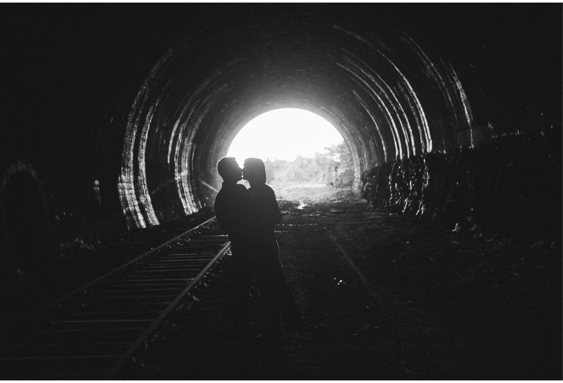 couple silhouette in a tunnel in vela draga ucka