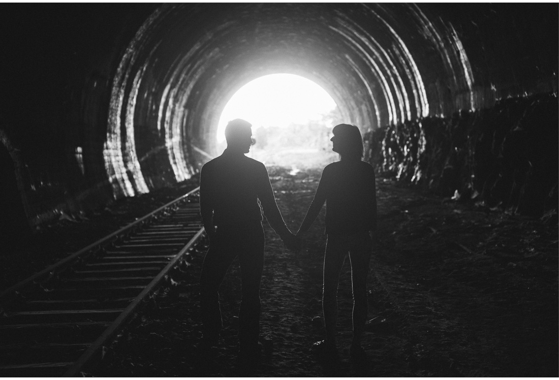 silhouette holding hands in a tunnel ucka mountain