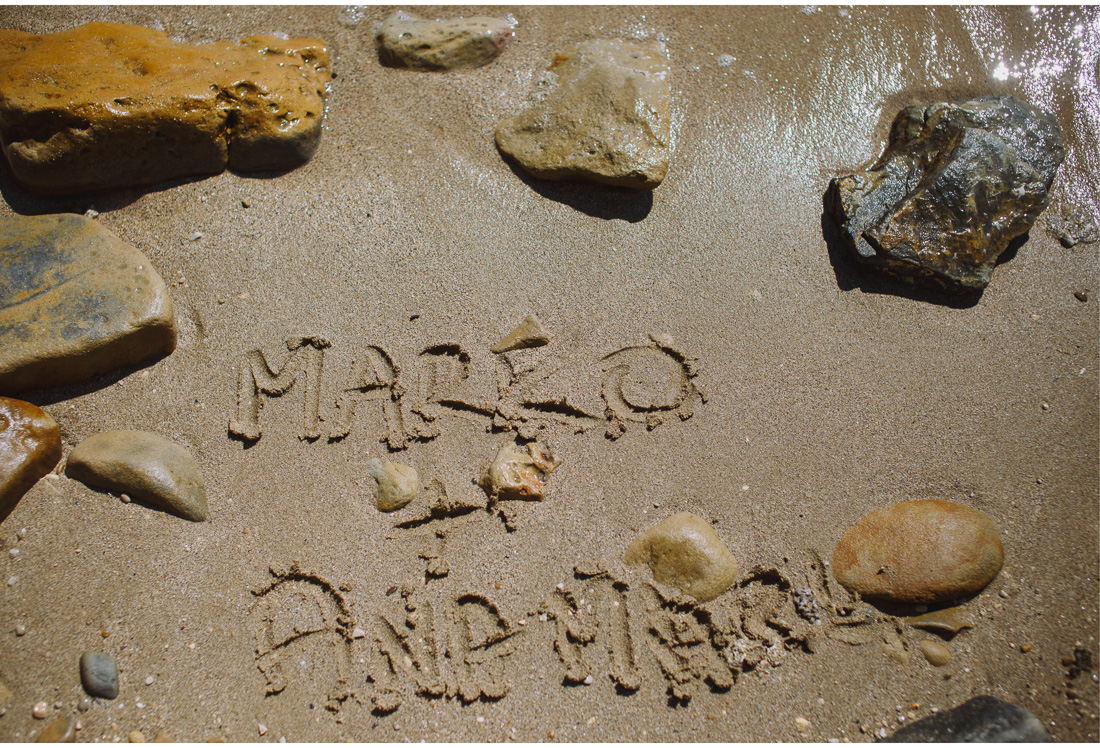 newlyweds names written in sand