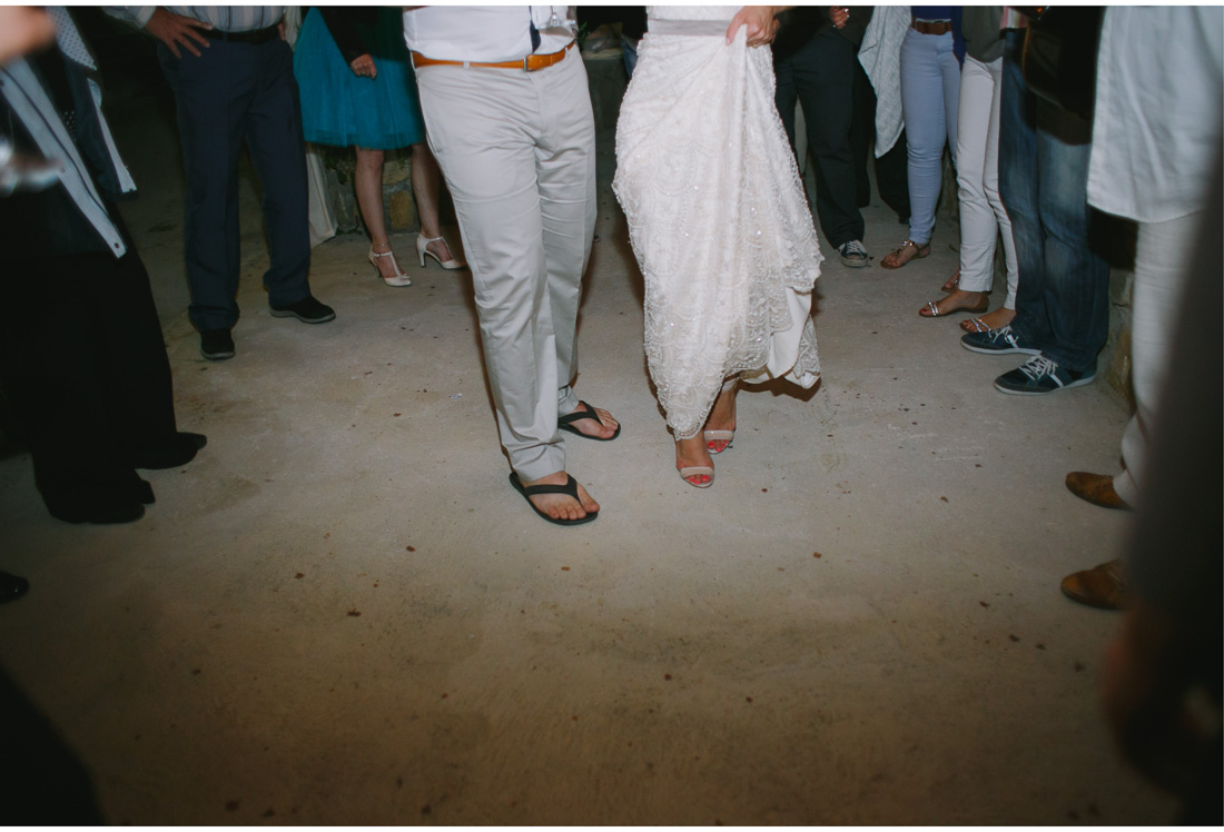 bride, groom and guests legs