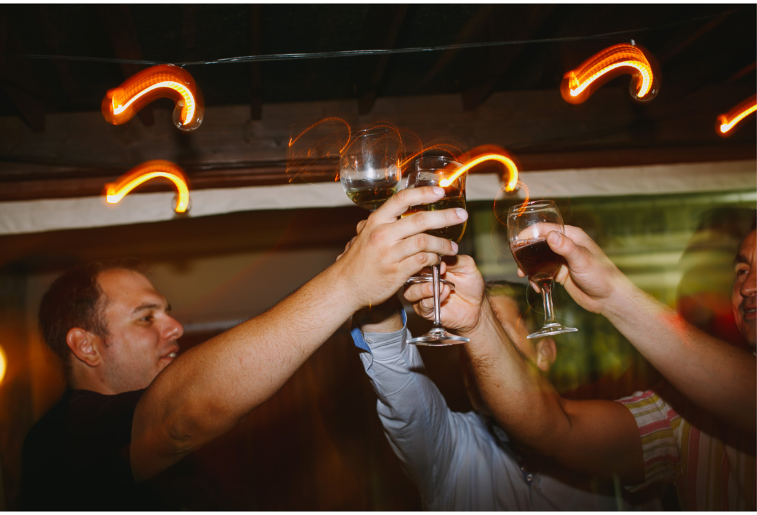 people raising glasses