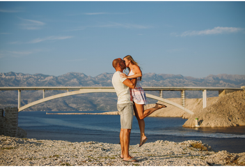 guy lifting girl in front of pag bride
