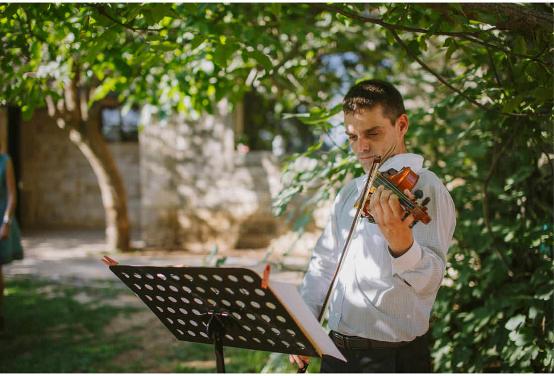man playing violin at a wedding