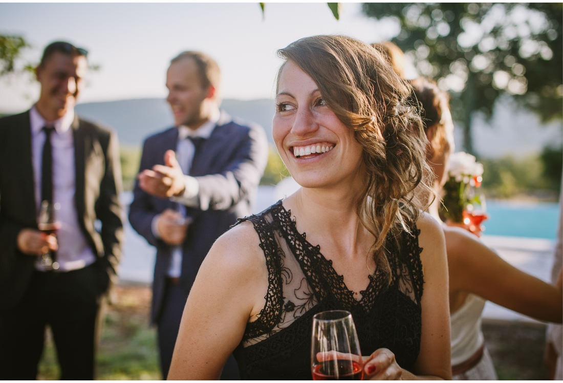 cute woman drink wine at a wedding