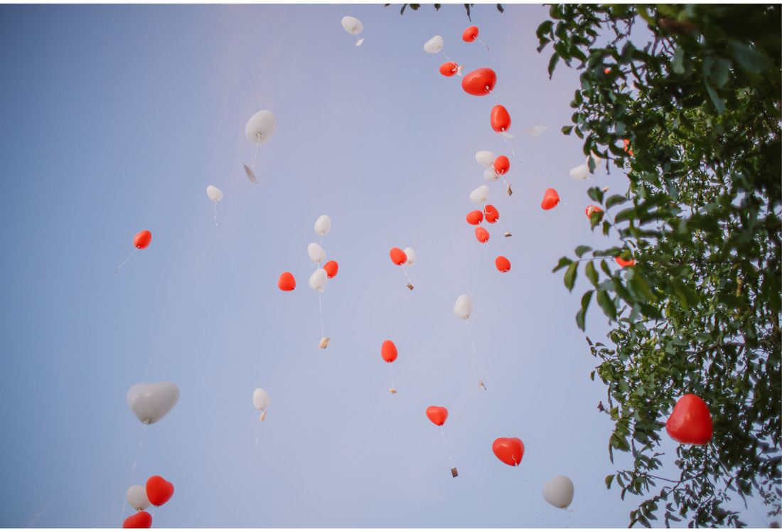 heart-shaped balloons fly