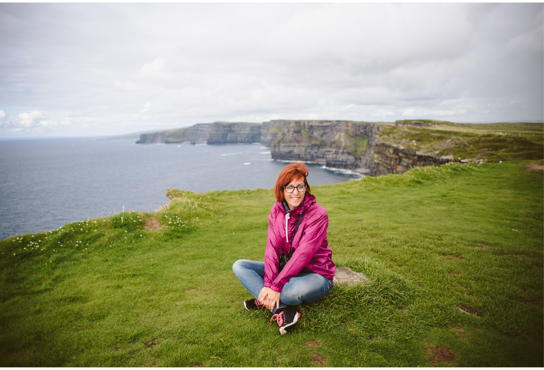 woman on cliffs of moher galway wedding photographer