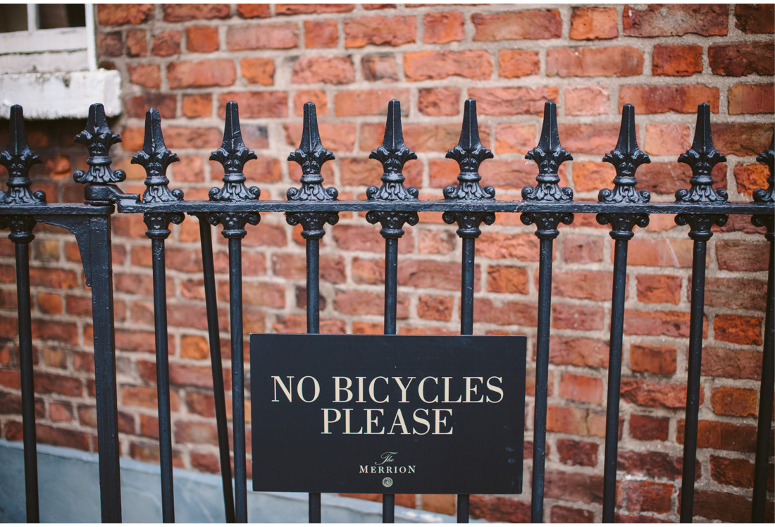 no bicycle please sign on a fence