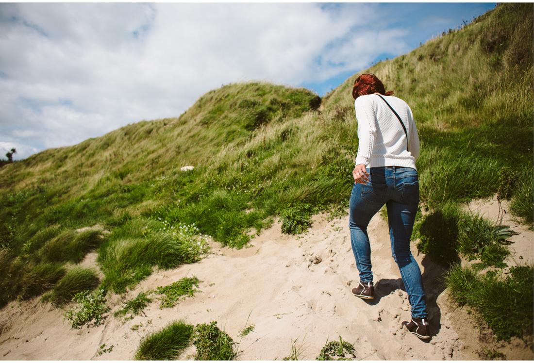 woman walking on the beach ireland