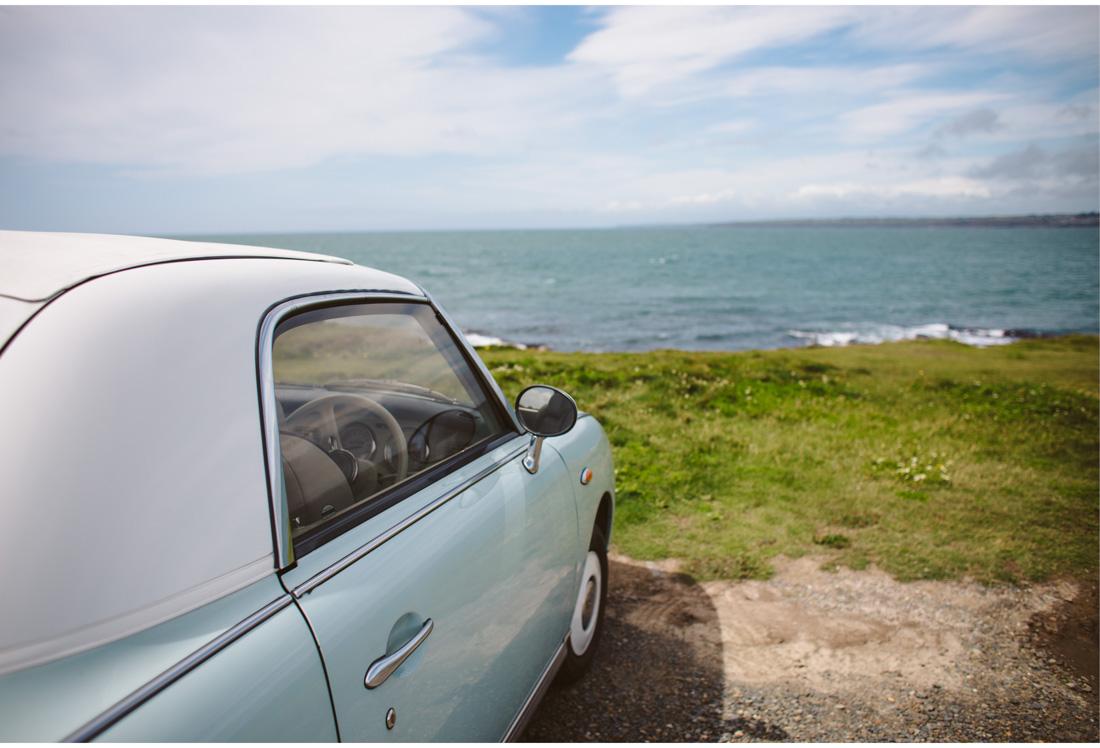 fancy old car on the beach in ireland