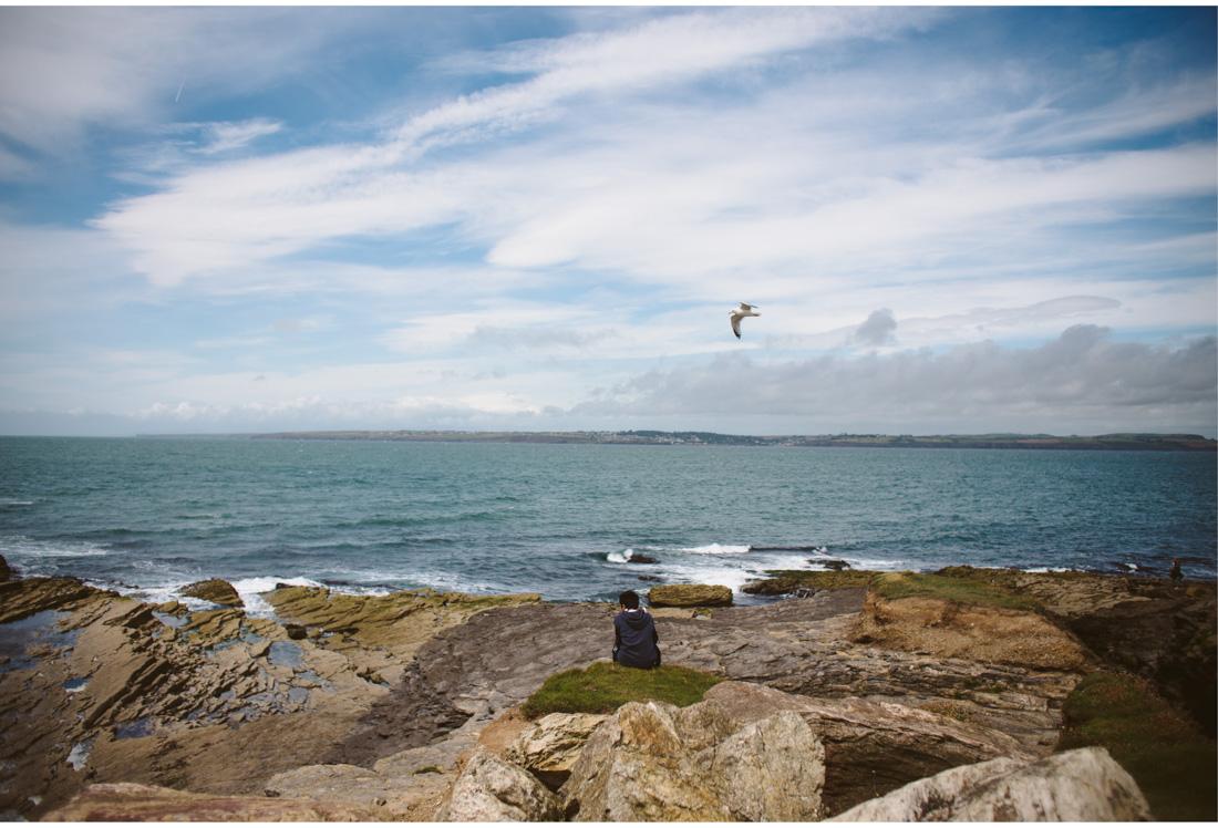 boy sitting on a beach in ireland