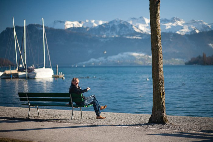 man sitting on a bench in switzerland