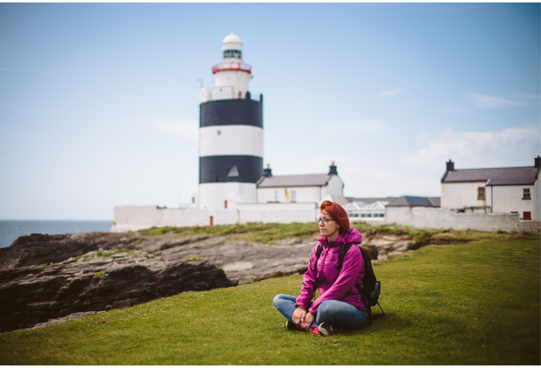 girl in front of hooks head lighthouse in ireland