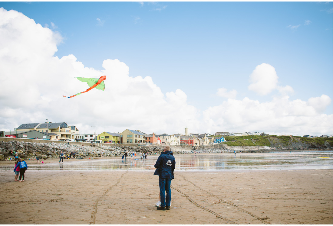 man with a kite in irish beach