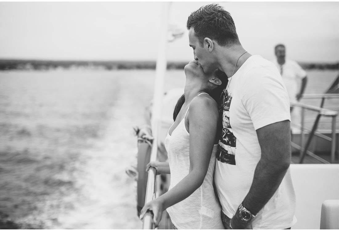 couple kissing on a boat to brijuni