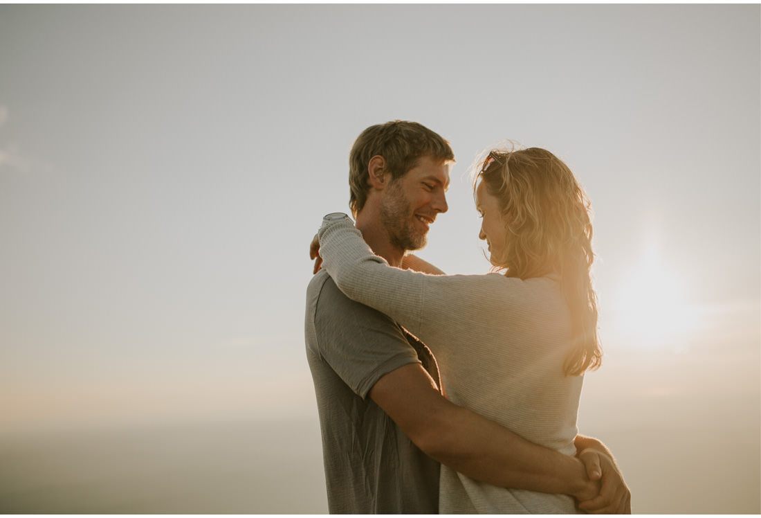 couple hug in sunset on a mountain