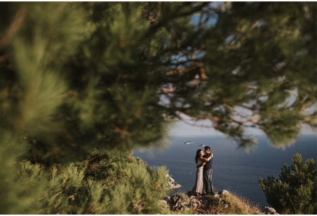 couple standing on a cliff dubrovnik engagement photographer