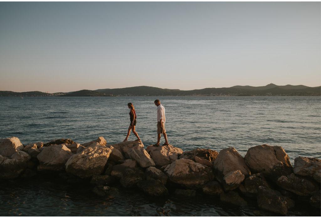 couple on rocks by the sea in zadar