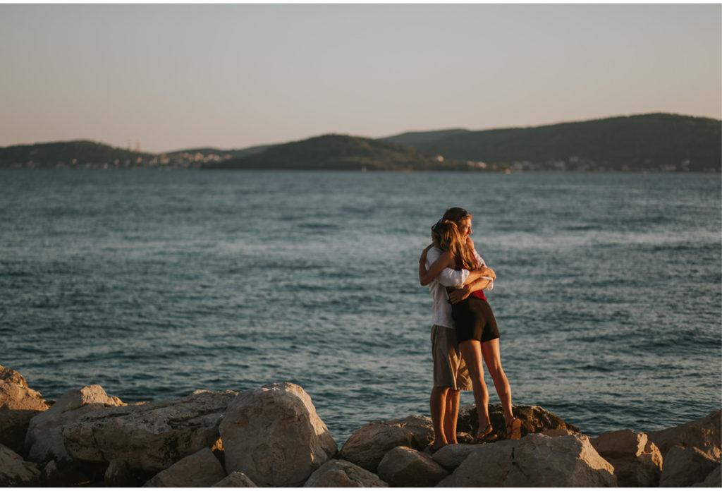 couple hug during sunset