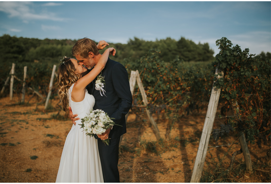 bride and groom in wineyard
