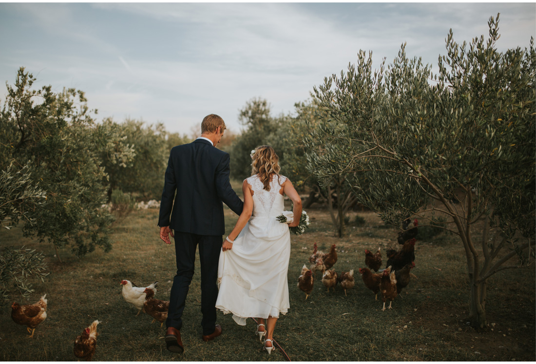 bride and groom surrounded by chickens