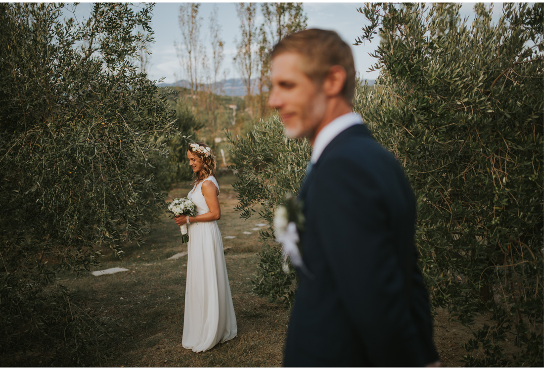 bride and groom in olive field