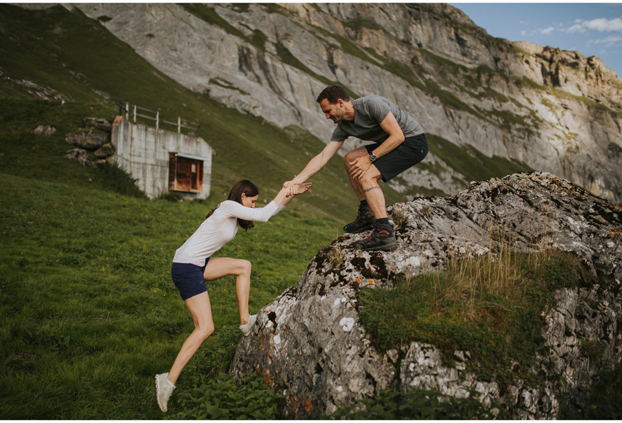 couple climbing swiss alps
