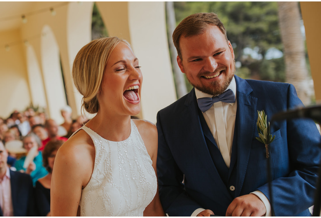 bride and groom laugh at their wedding