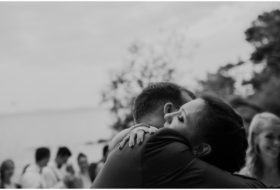 people hugging at a wedding