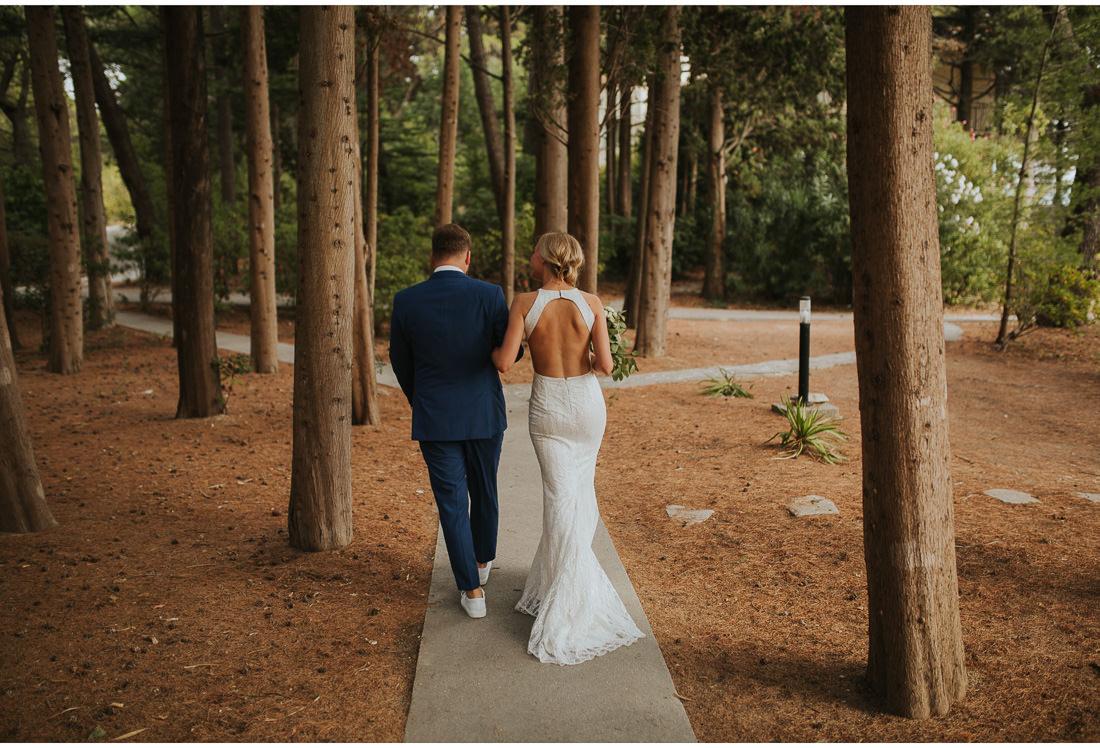 bride and groom walking in villa dalmacija garden
