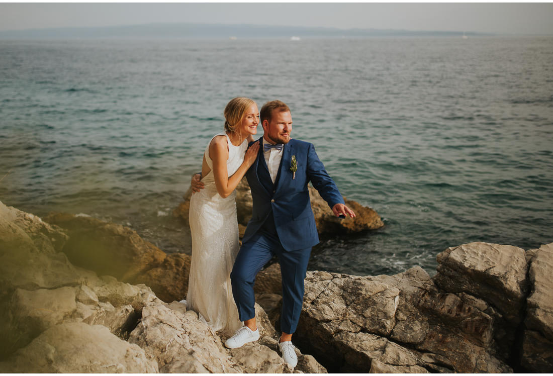 bride and groom in a blue suite