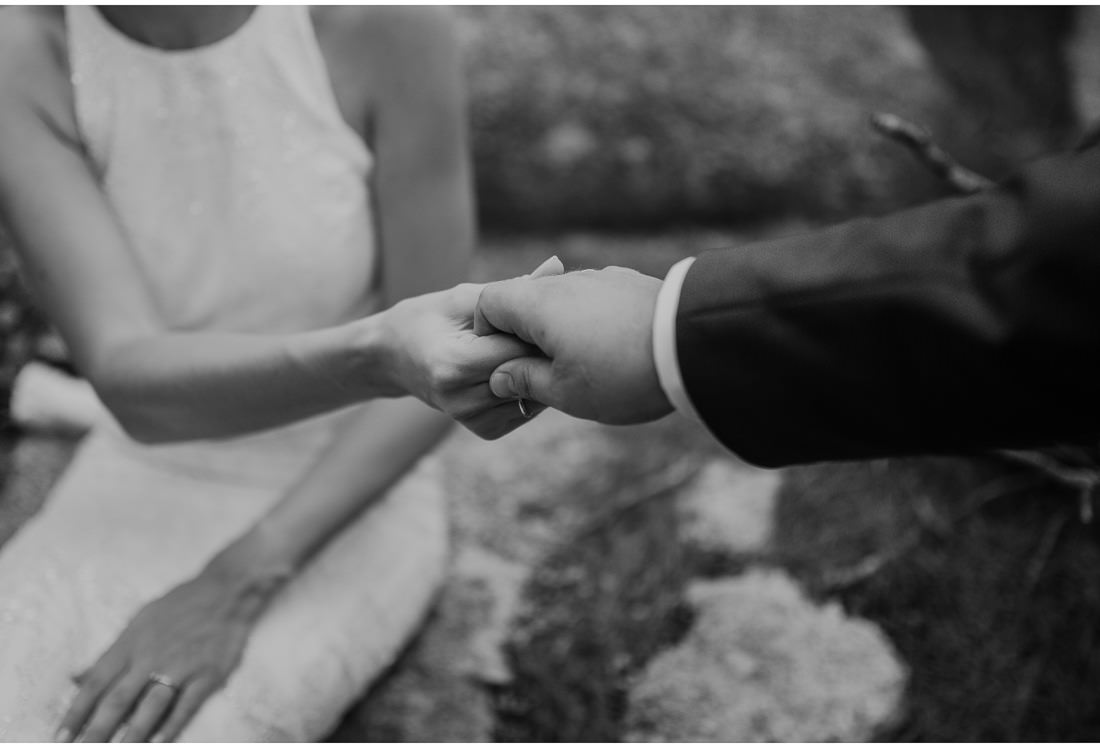 bride and groom hold hands