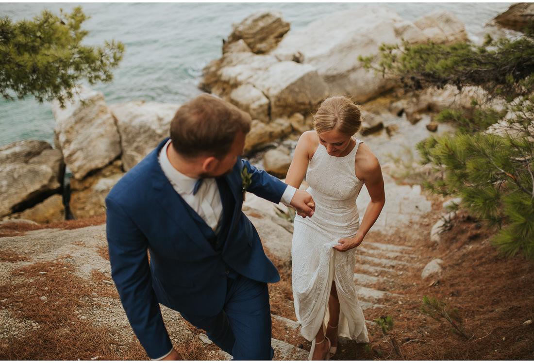 bride and groom walk at villa dalmacija wedding