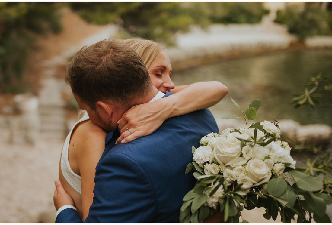 bride and groom hug in front of villa dalmacija