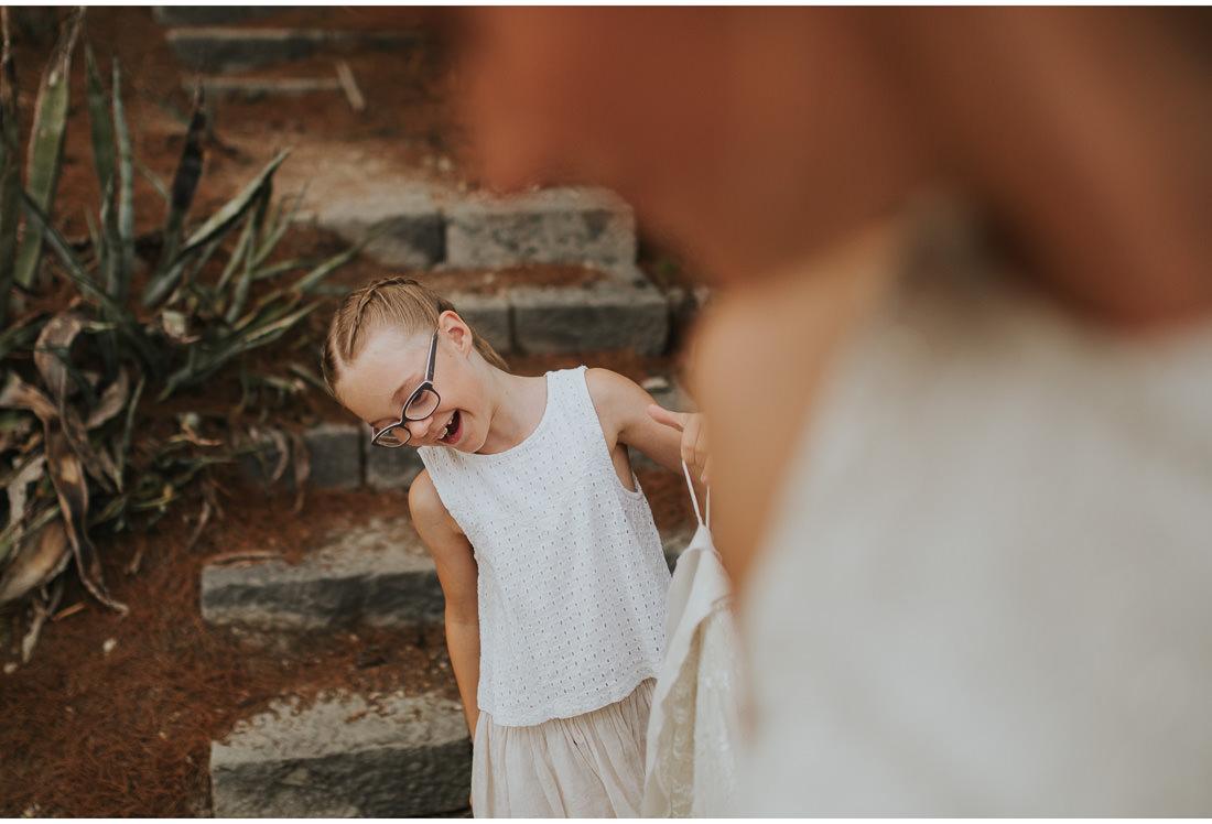 cute girl holding wedding dress