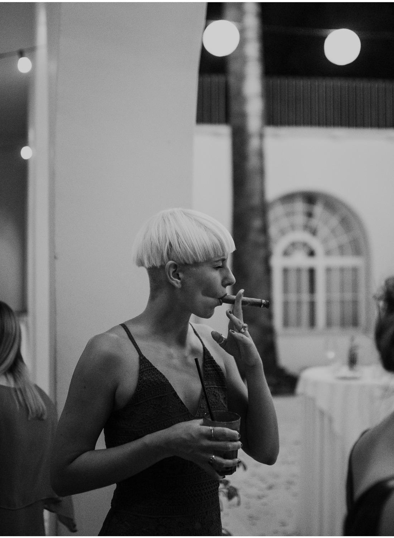 badass women smoking a cigar at villa dalmacija wedding