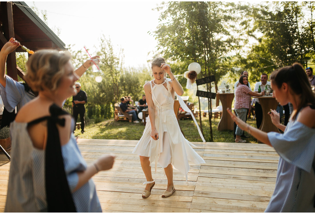 outdoor backyard wedding party girls on a dancefloor